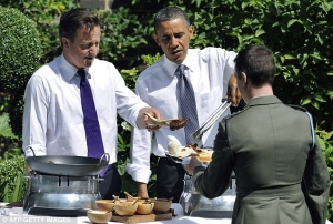 David Cameron and Barack Obama today served hotdogs and burgers .