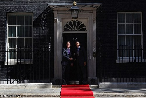 Cameron and Obama pose for the army of press photographers gathered outside 10 Downing Street